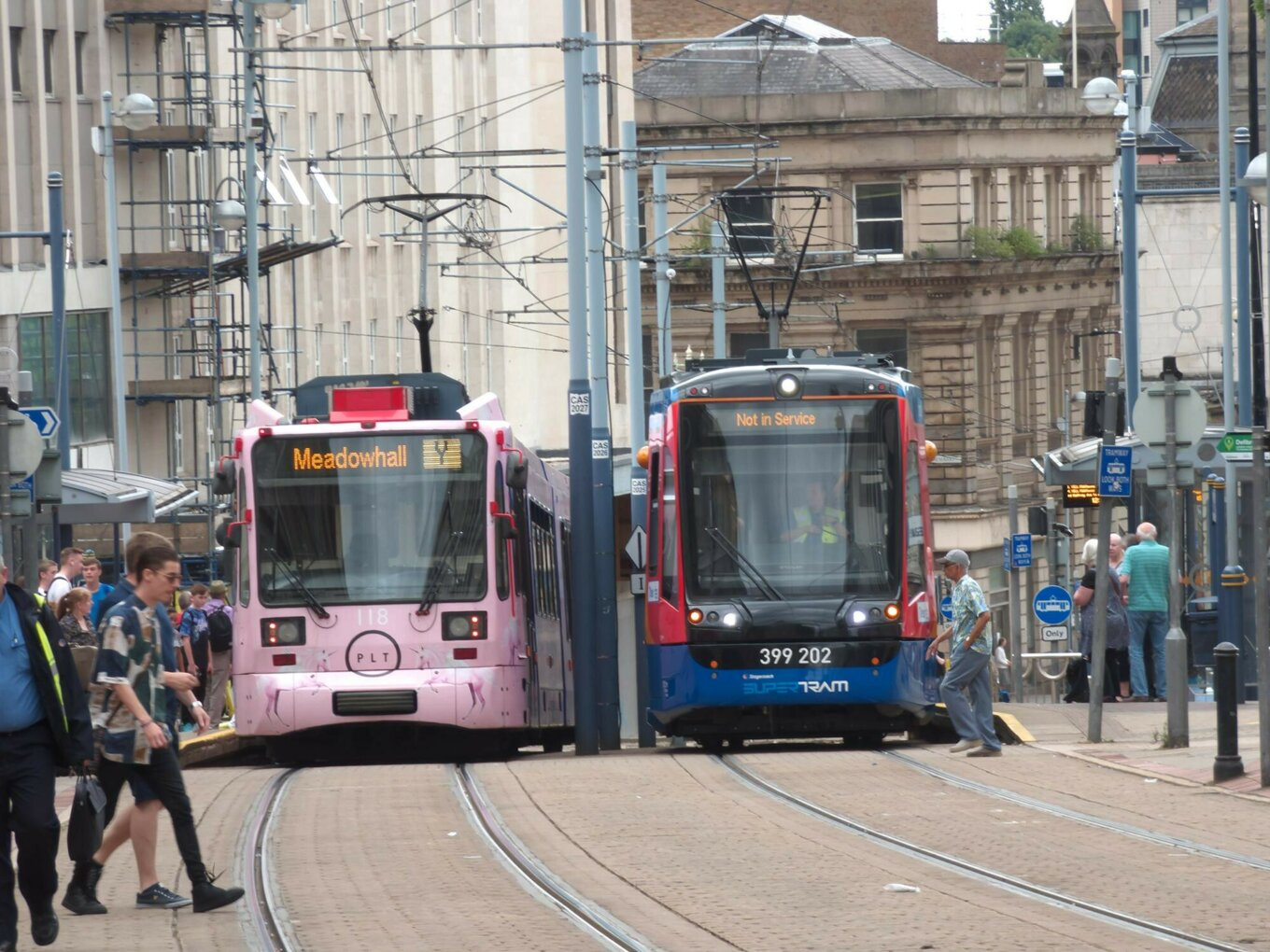 Two trams in Sheffield city centre