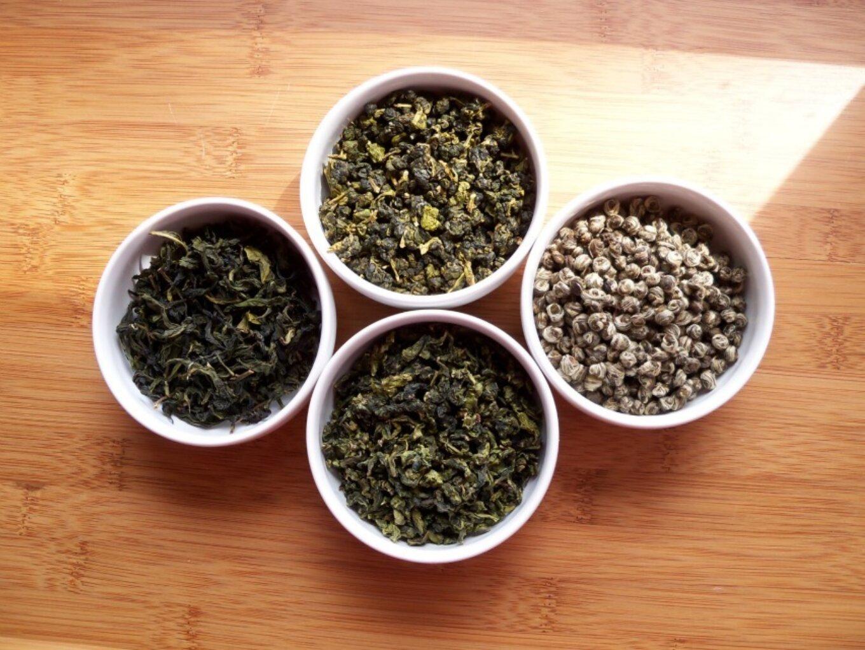 Green teas in white bowls