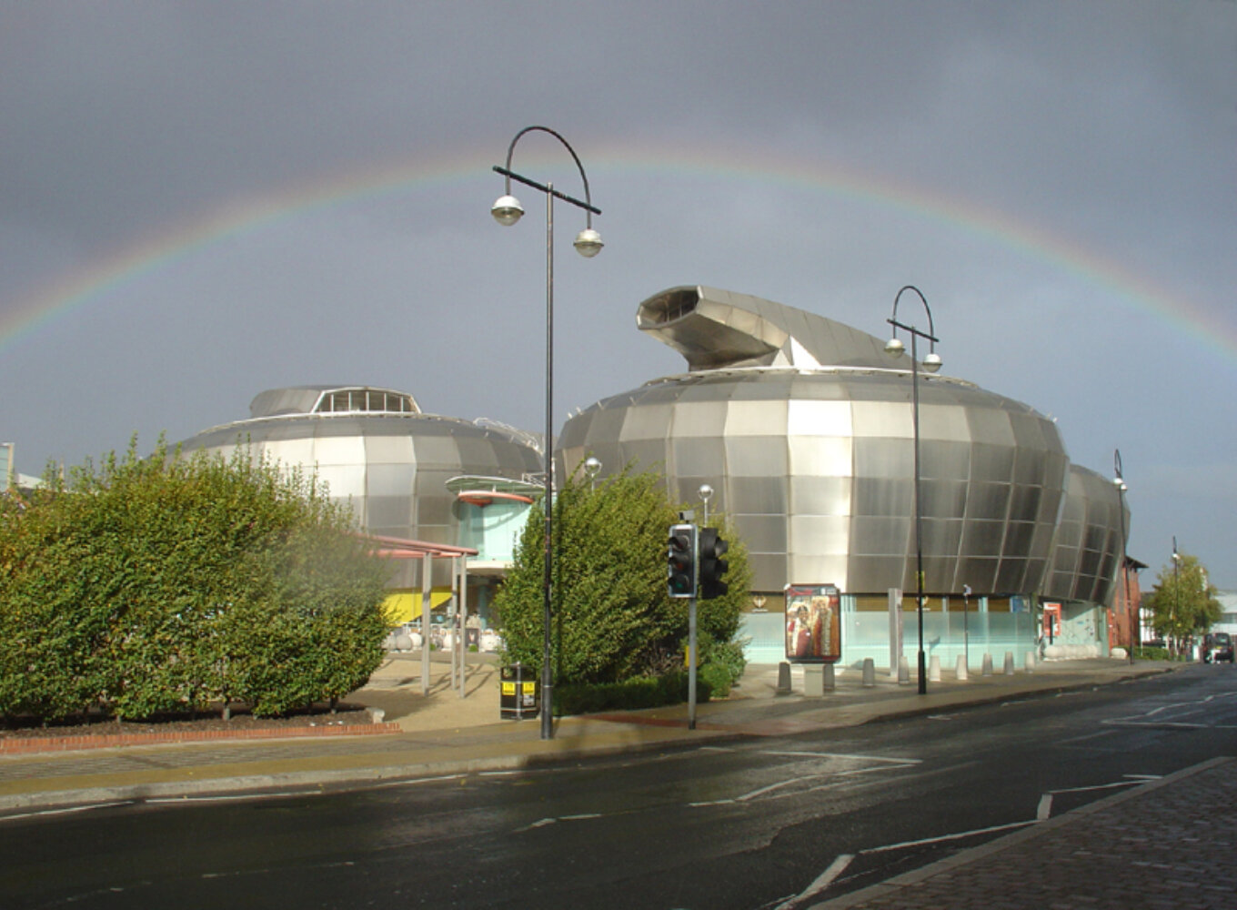 A photograph of the Hubs in Sheffield with a rainbow in the sky