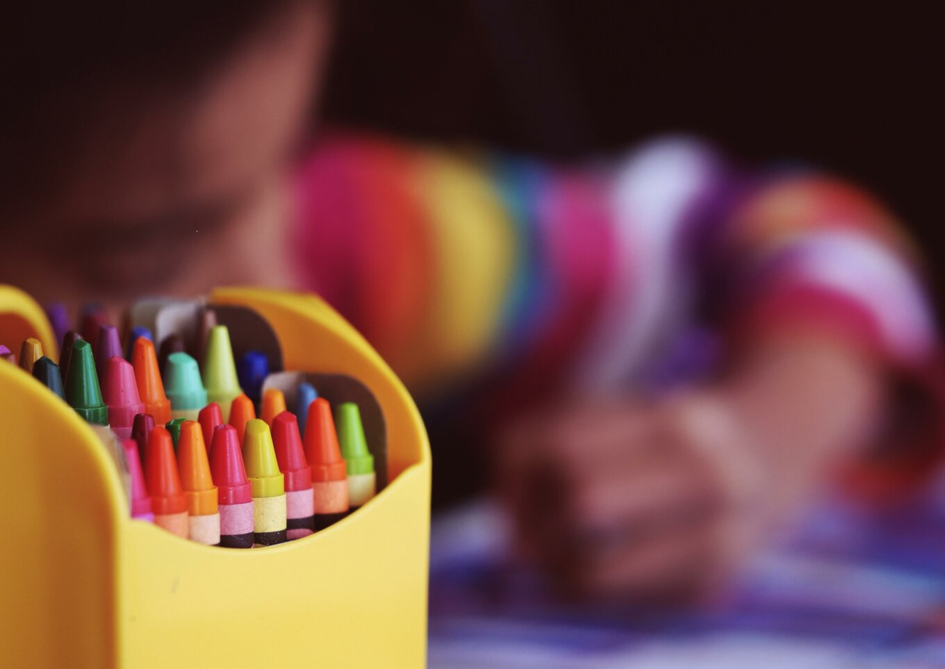 Crayons by a child colouring