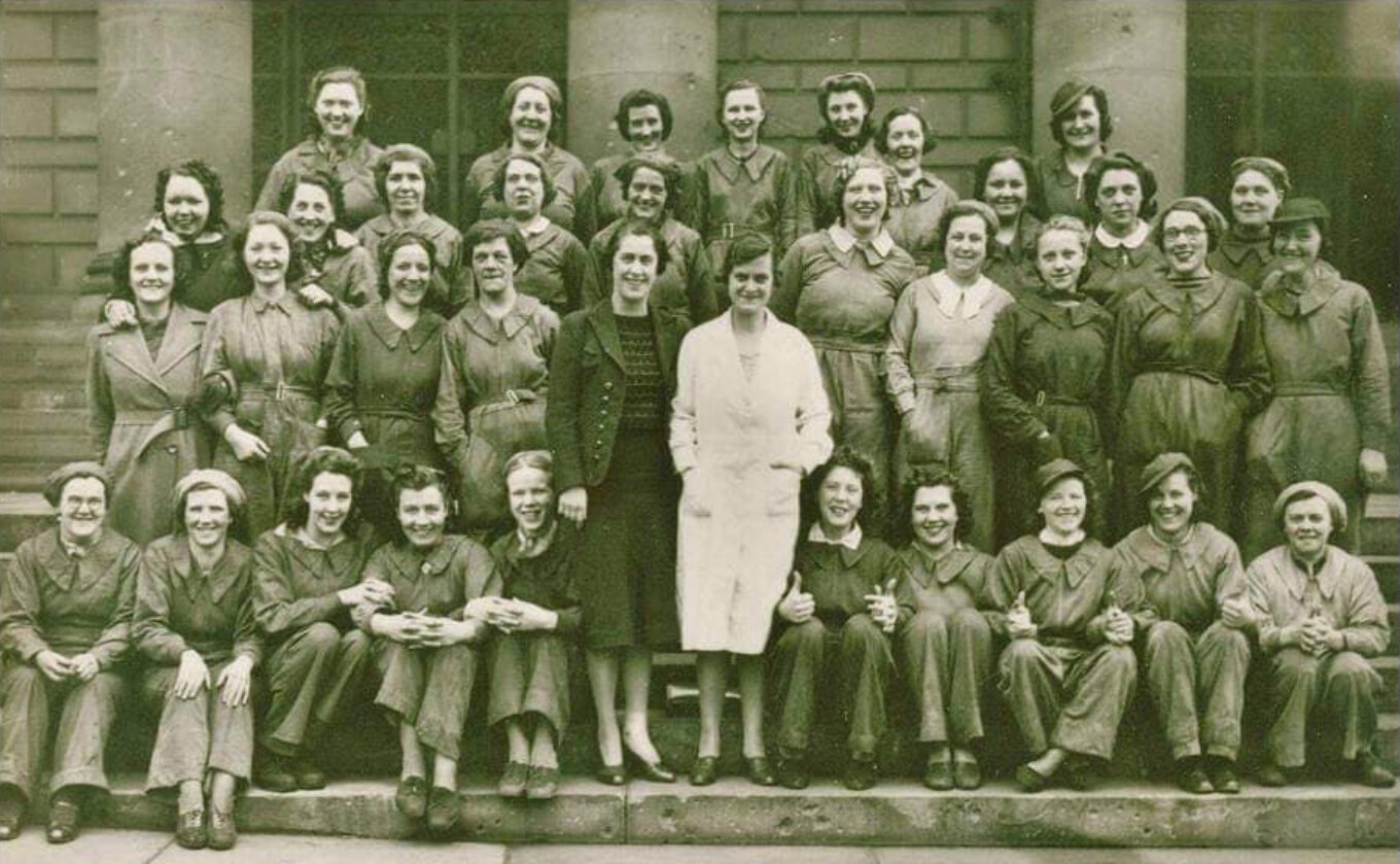 Group of women outside English Steel Corporation during WW2