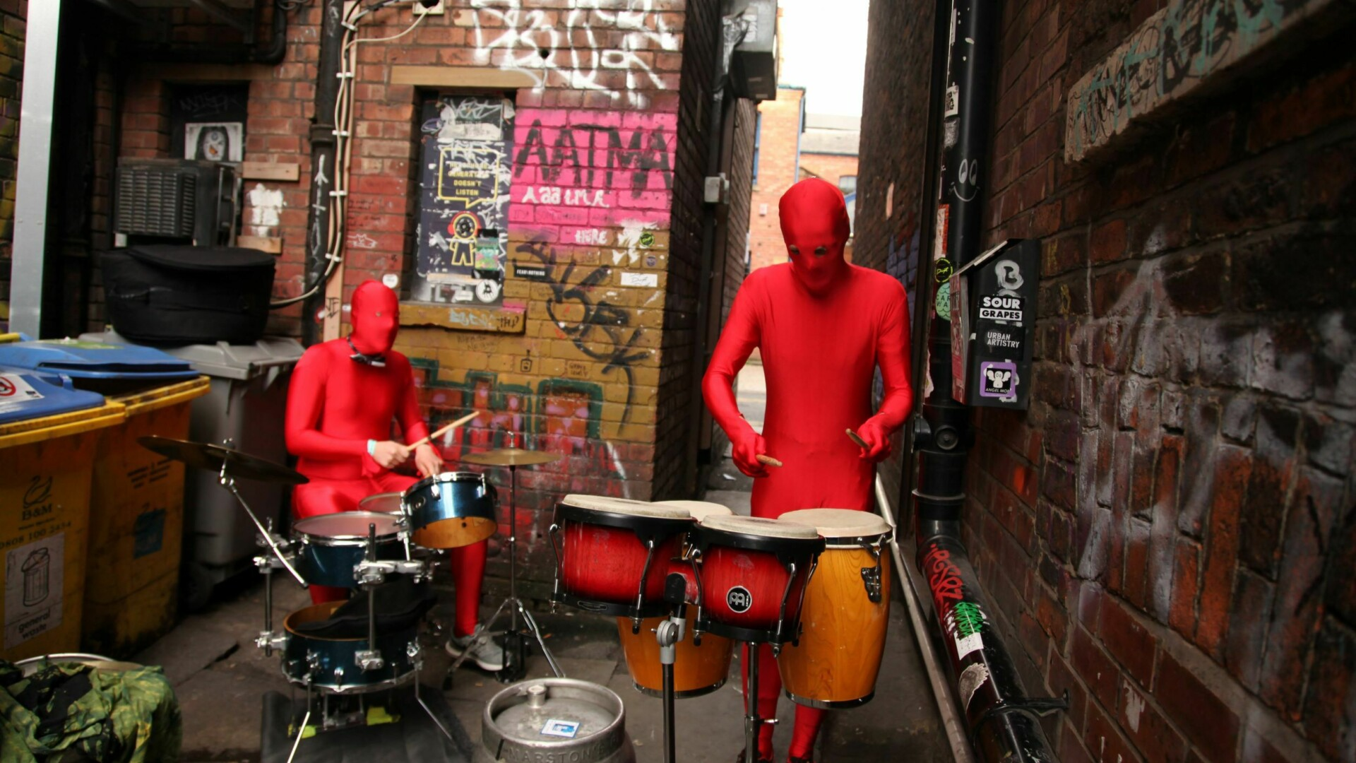 A band performing a gig outside the Peer Hat venue in Manchester