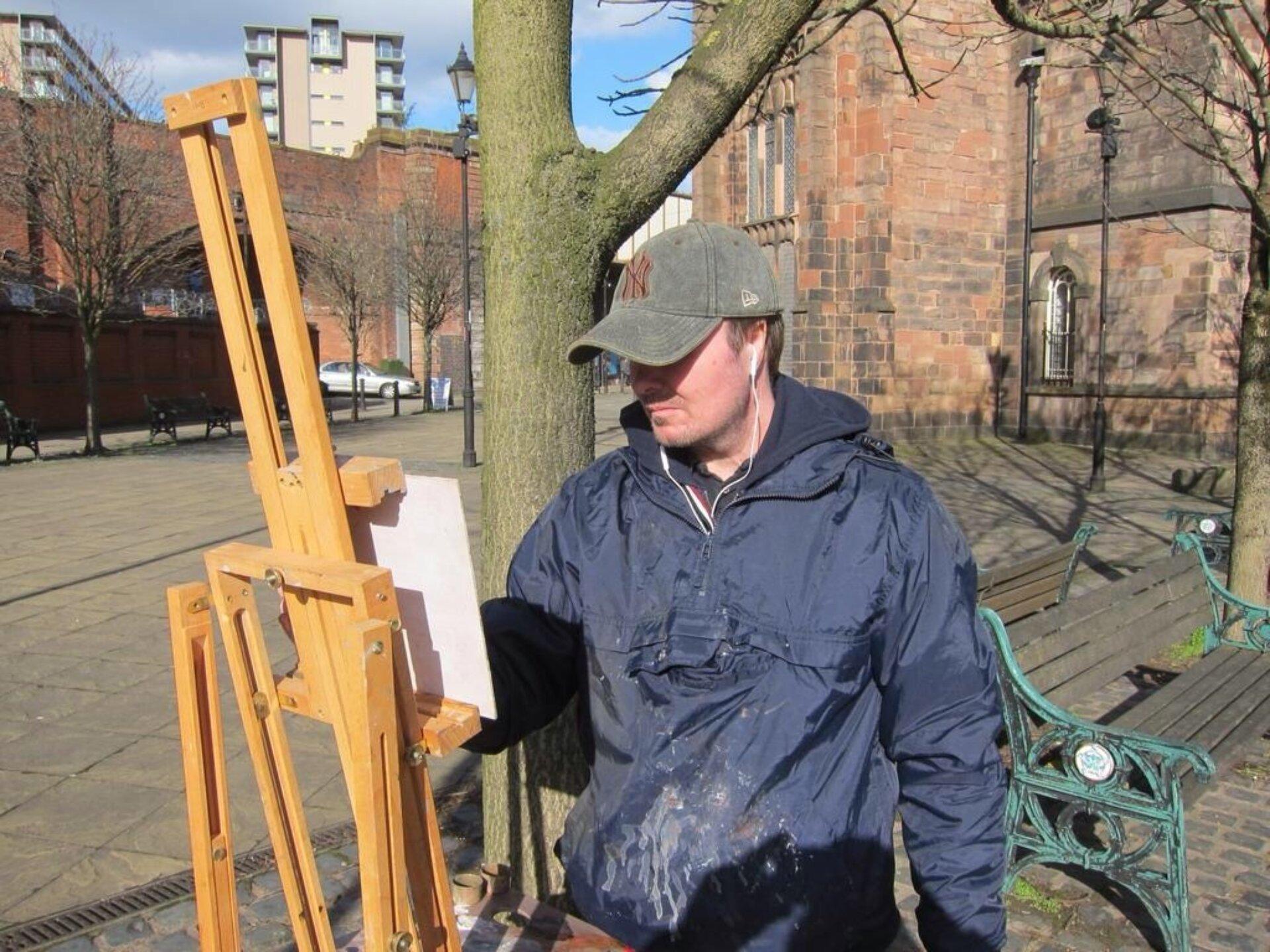 Michael John Ashcroft painting on easel