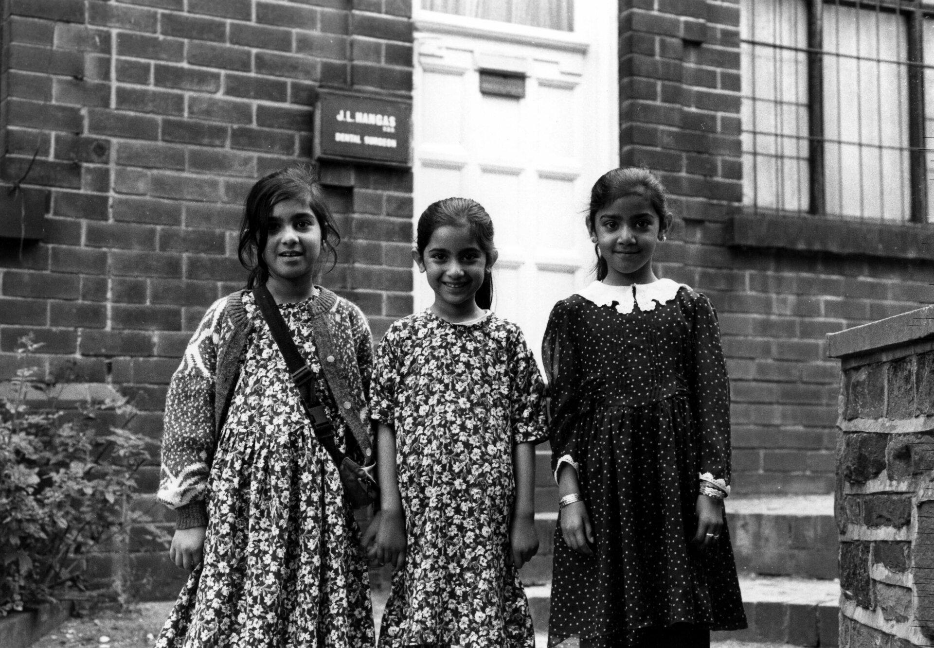 Three young Asian girls outside J L Hangas dental surgery No 225 Barnsley Road Sheff Archives