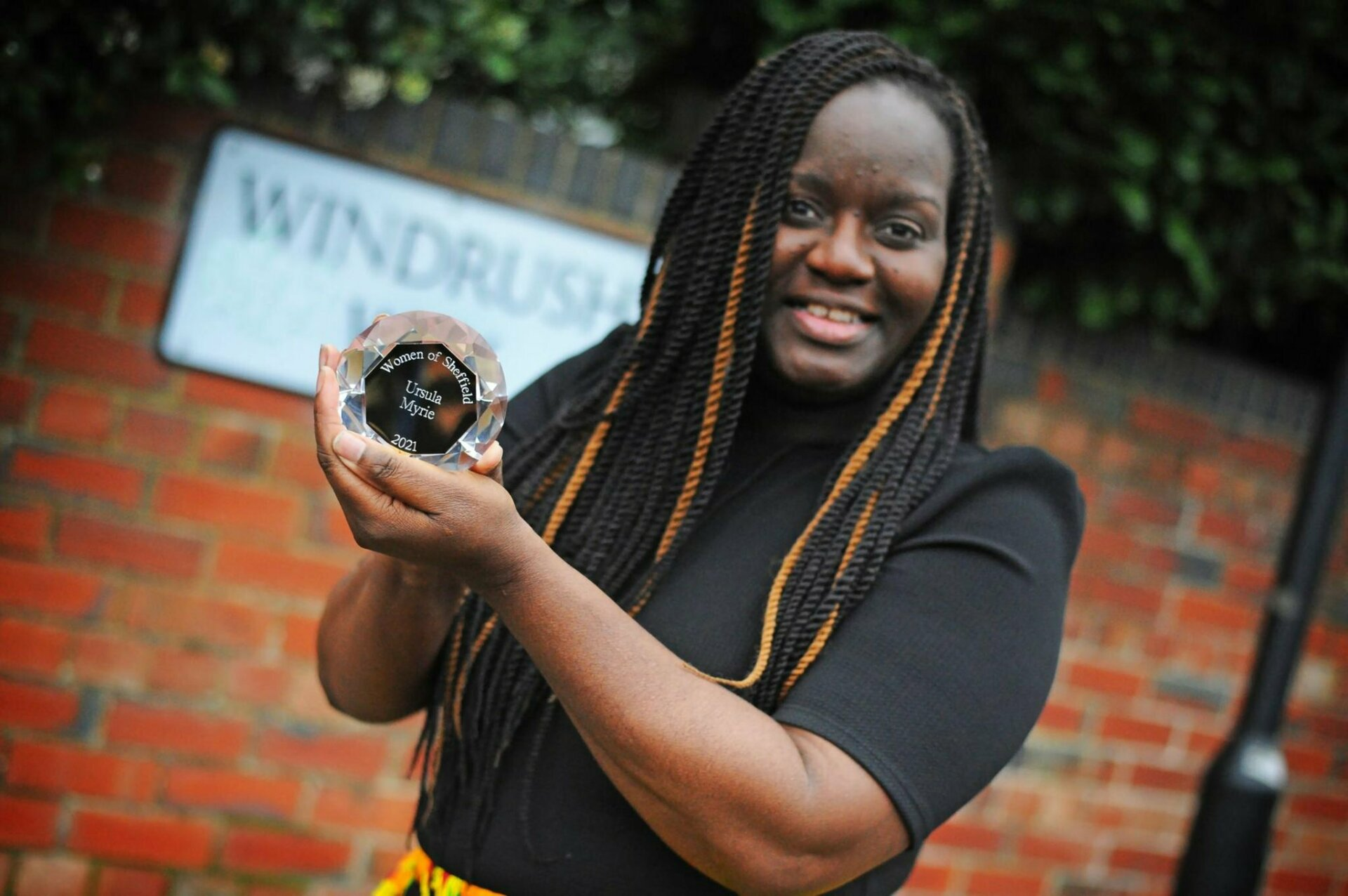 Ursula Myrie with the Barbara Wragg Award for Charity for the Adira Food Pharmacy