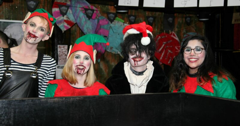 People dressed in Halloween costumes at the Peer Hat