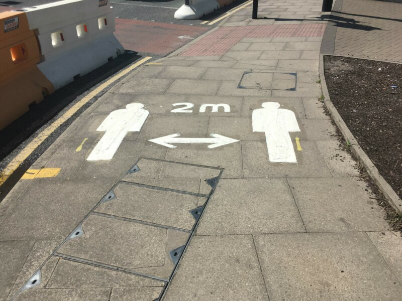 Social distancing paint on the footway